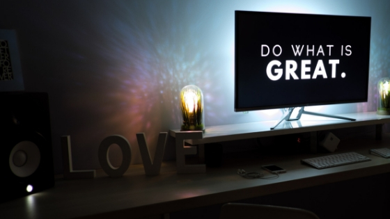 blog banner with a tv screen reading a message 'Do what is great'