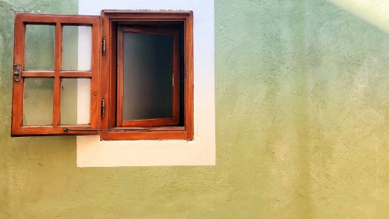 an open window outside a wall
