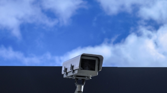 security camera outside a building and the sky visible above it
