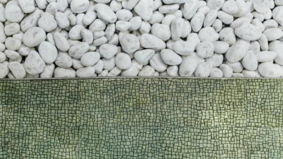 Half white pebbles, half green tiles