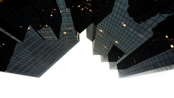 upside down image of high rise glass building