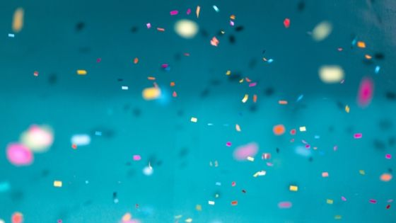 confetti all over against light blue background