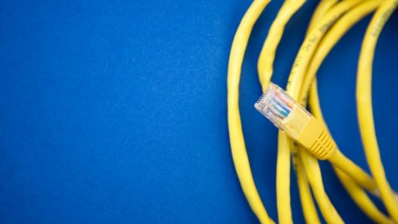 yellow wire on extreme right corner against blue background