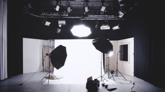example image showing a photographer studio in black and white colour with lights facing in towards the center