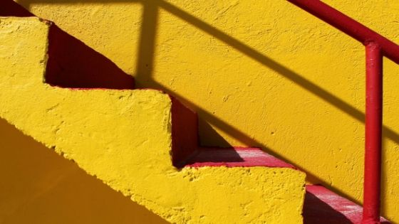 a yellow stairs and its shadow