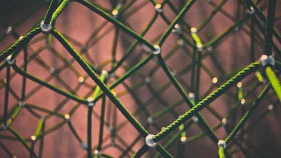 close shot of football net showing green coloured wires