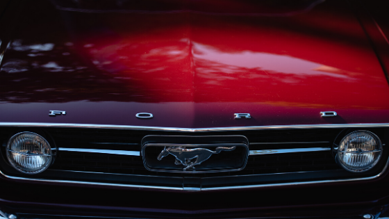 close up photography of front view of red Ford car