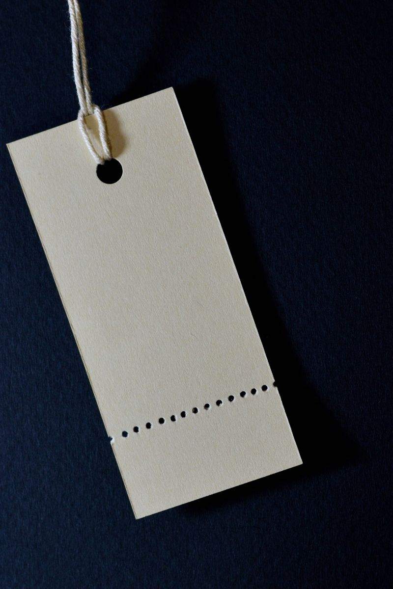 A blank tag is seen hanging off of a thread.