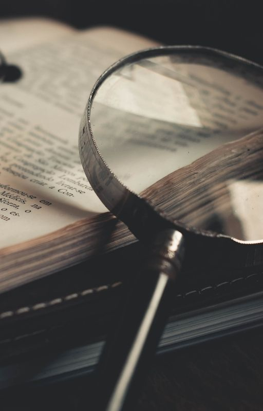 magnifying glass kept on a book