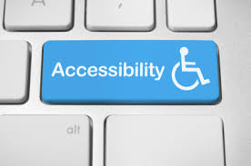 a white keyboard with blue key on which accessibility is written and a stick man in a wheelchair on right
