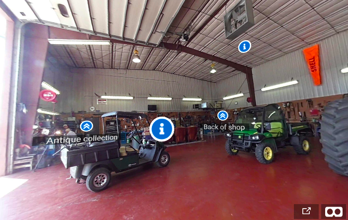 Two vehicles kept inside a car shop with icons denoting 'Antique collection' and 'Back of shop' overlaying them