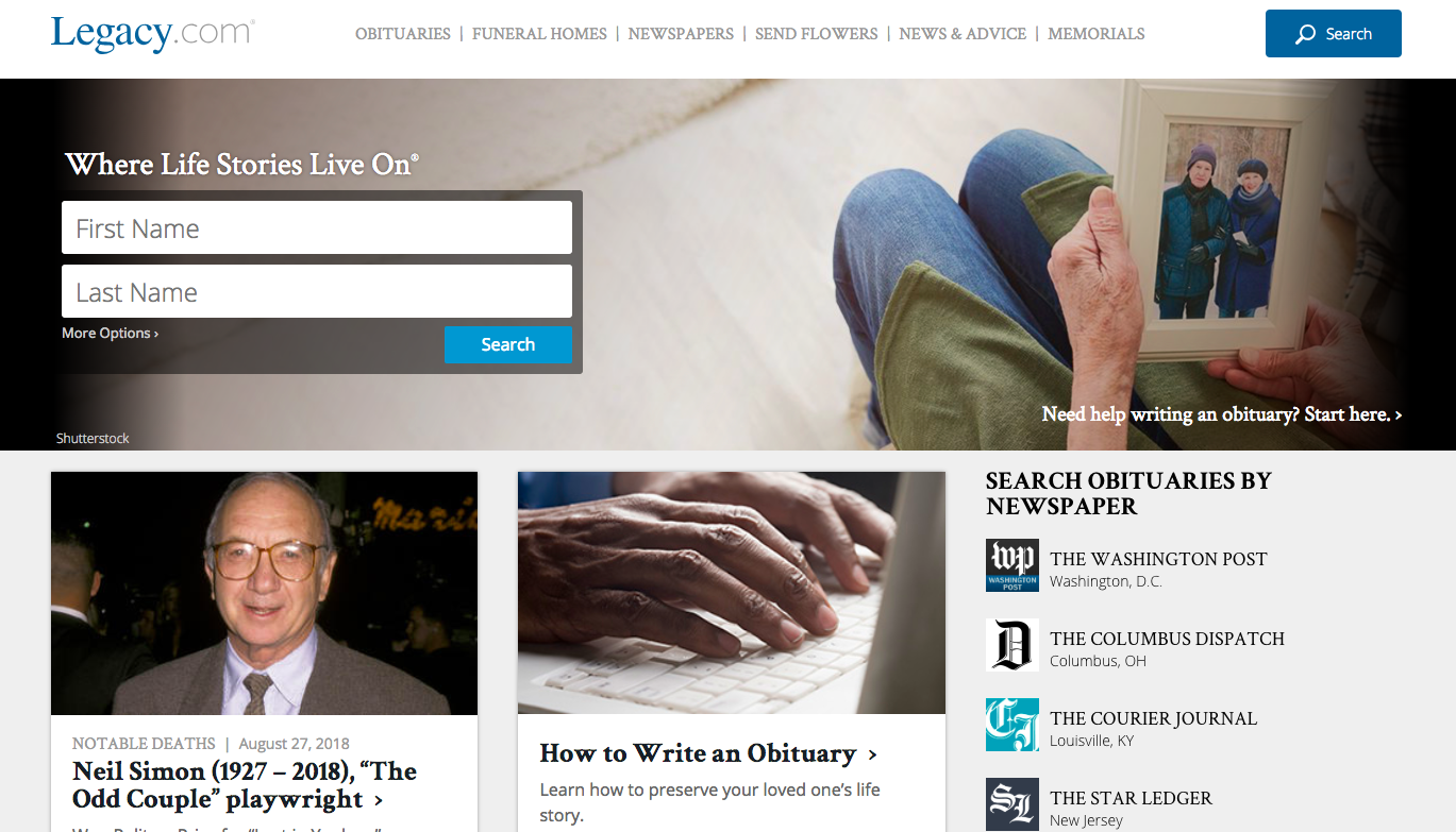 Homepage of Legacy with a person holding a framed photo