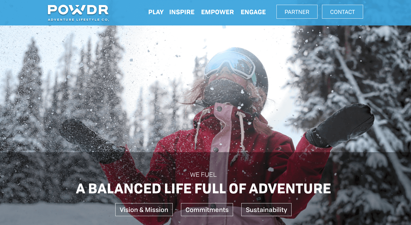 Homepage of Powdr with a woman enjoying snow
