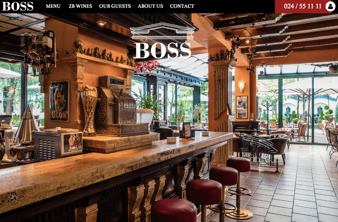 Home page of Drupal powered food-based website of Bosscaffe showing a restaurant hall with chairs and transparent glass-wall