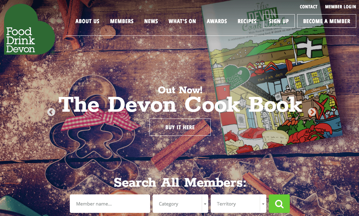 Homepage of Food Drink Devon with the image of a book kept on a wooden surface