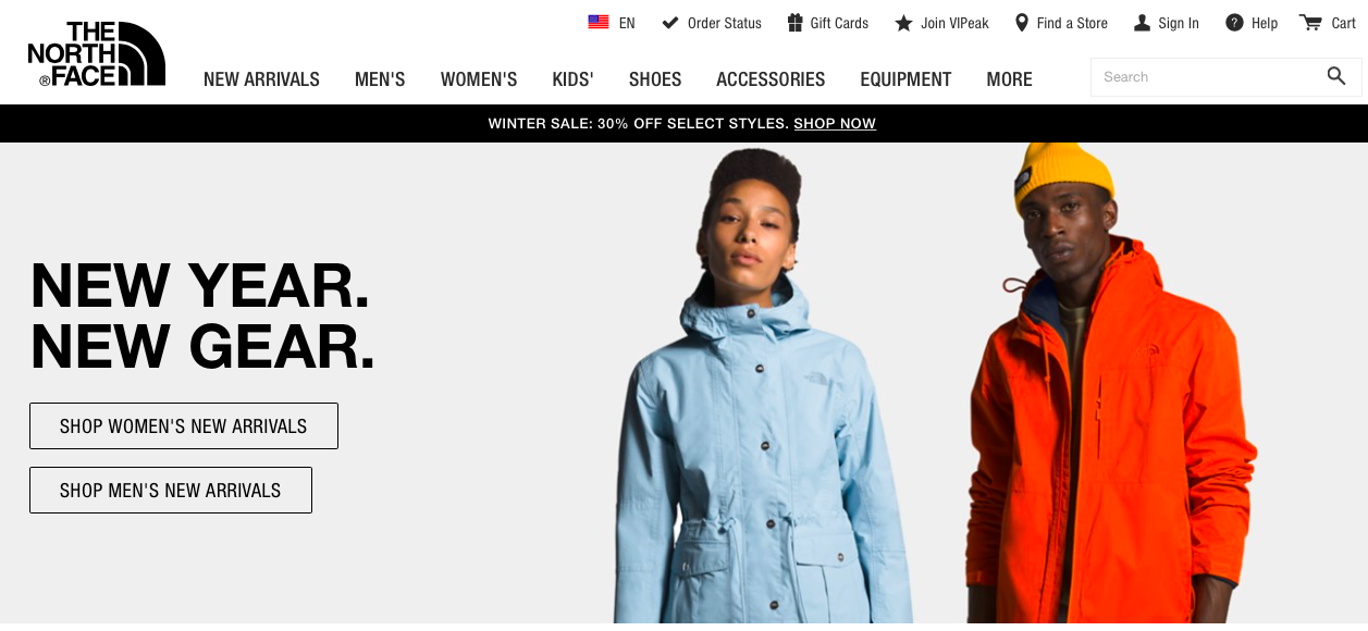 e-commerce site homepage with a couple standing and facing camera