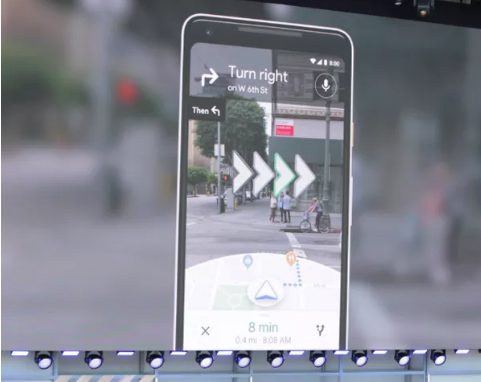 A smartphone showing Google Map's augmented reality feature