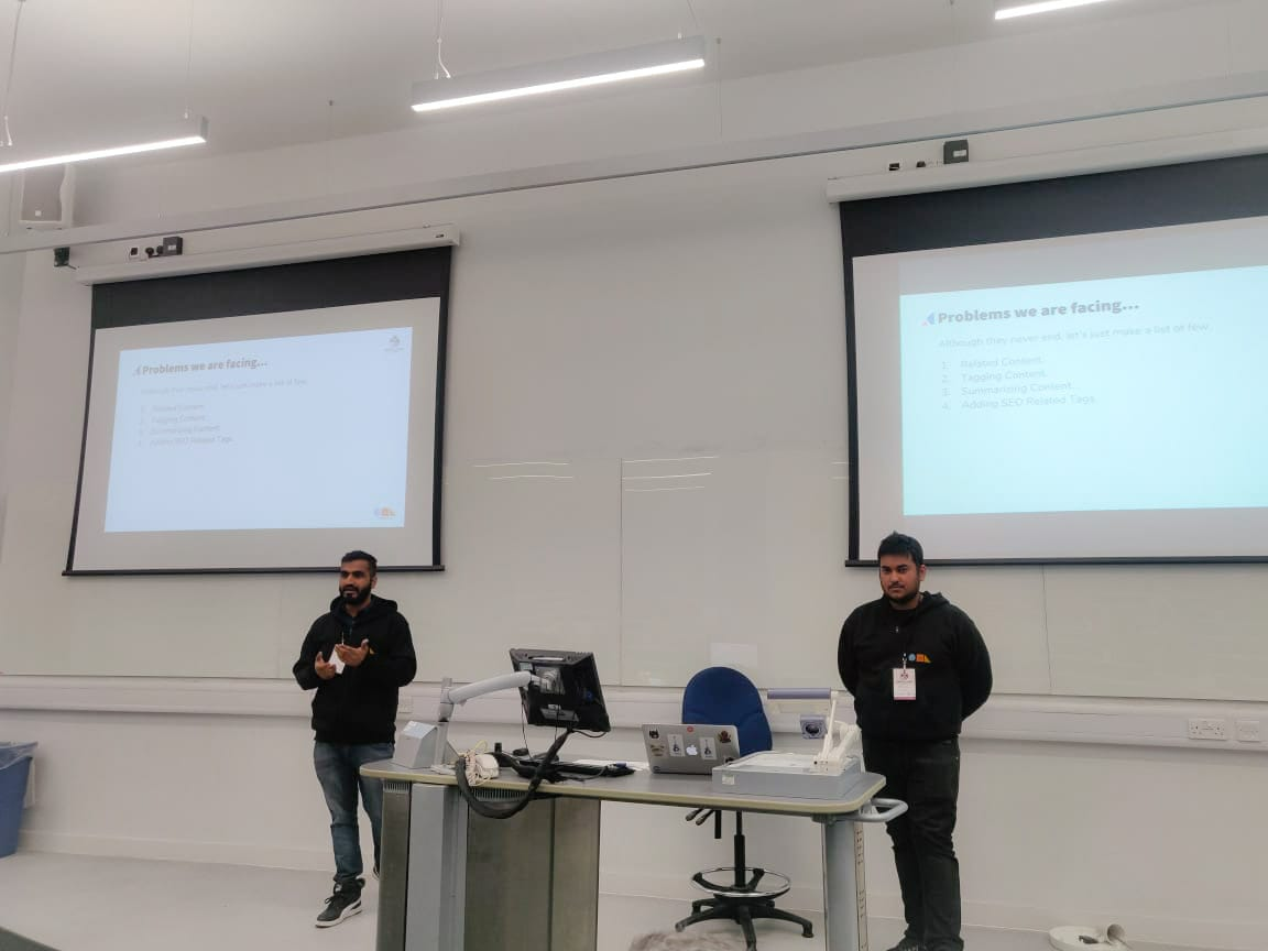 team presenting a session at Drupal camp London