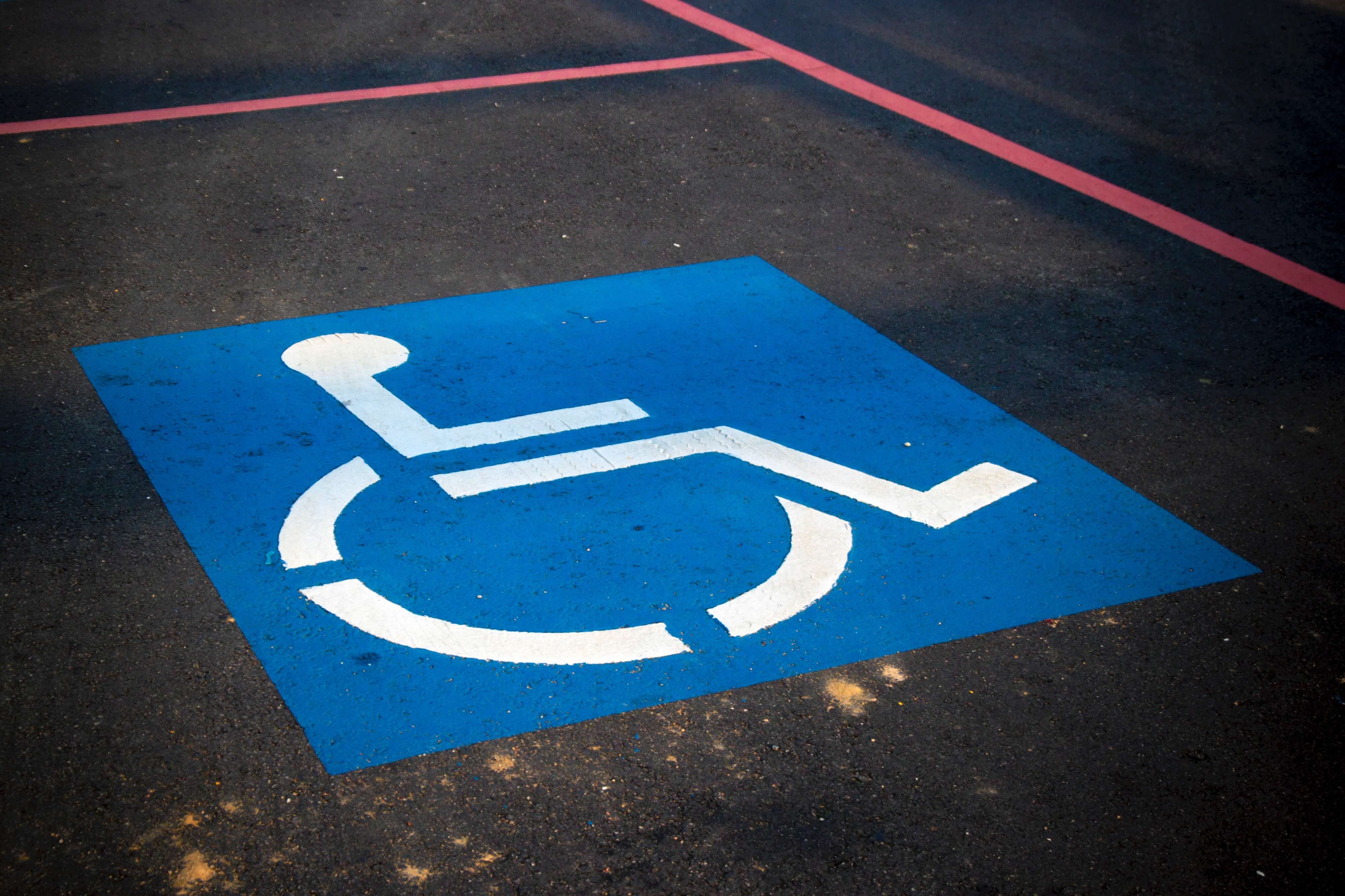 A wheelchair symbol drawn on road for accessibility awareness