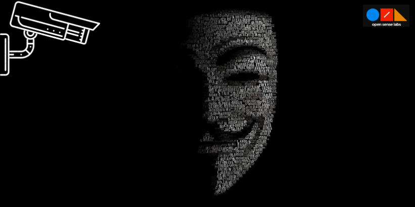 anonymous mask on a black background with a cctv on top left corner