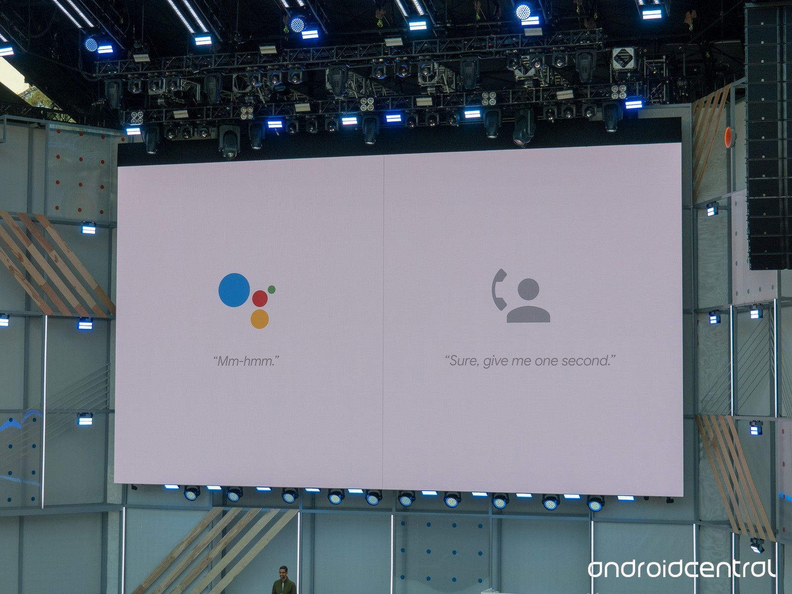A big screen showing two images - one of google duplex logo and another of an icon representing a human phonecaller