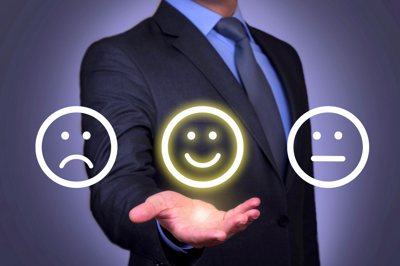 A headless man in suit holding a frown, smiling and poker emoticon in his palm