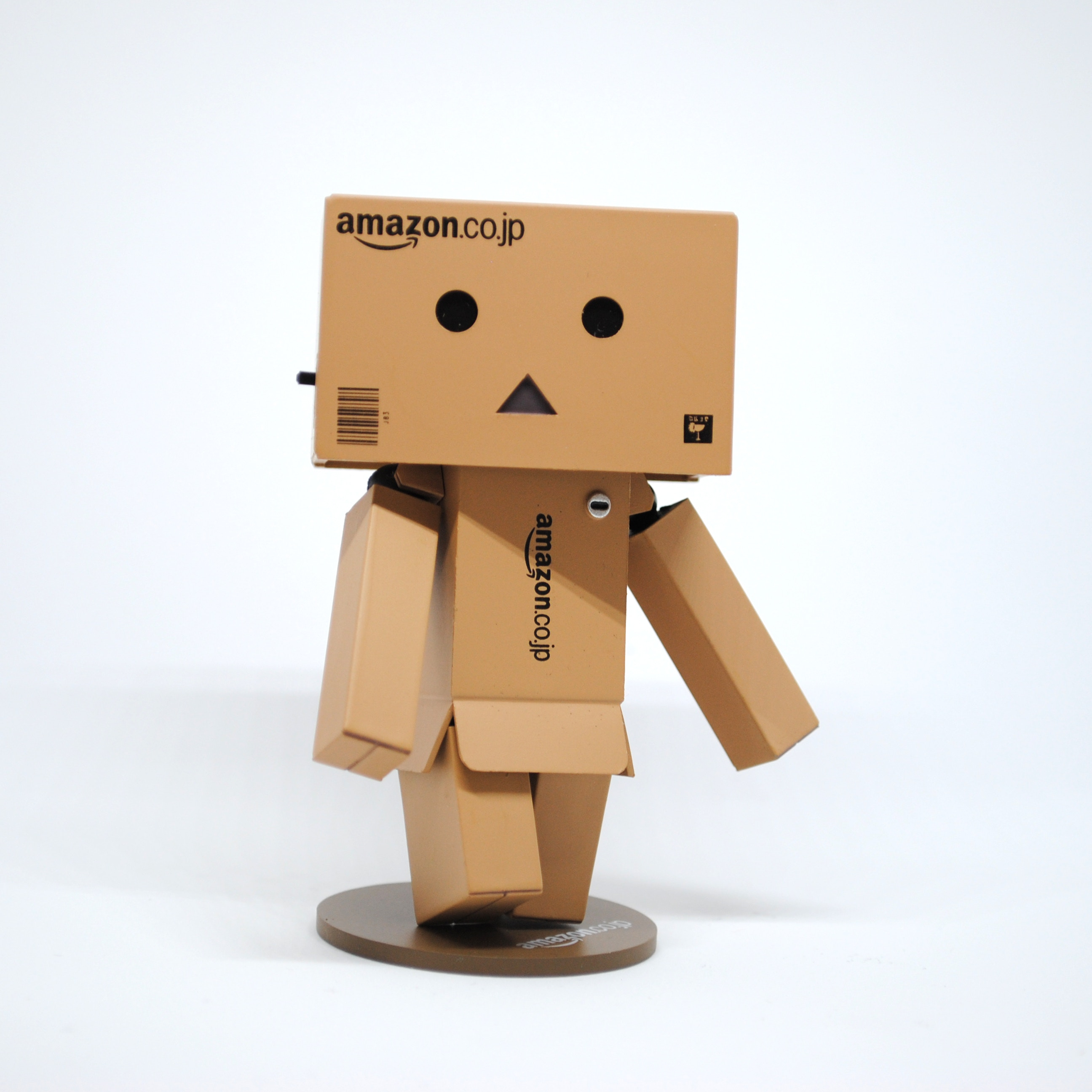 A miniature of robot in card board by Amazon
