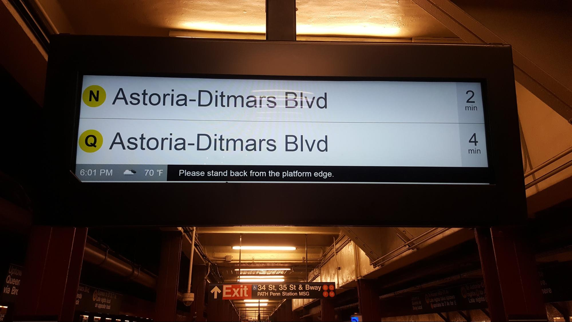 A digital signage screen in New York railway station reading station name and time of arrival