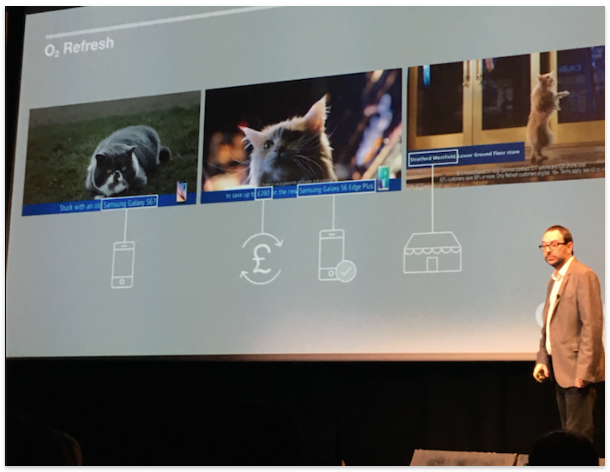 A man presenting the session with a grey screen showing three cats in three pictures and O2 refresh written on top left