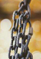 Rusted iron chains with yellow background