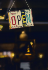 a sign board saying 'Open'