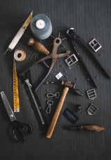 A set of tools against a black background