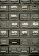 image showing vintage drawers to store things inside in grey colour labelled with white stickers