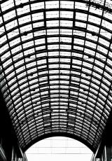 a photo of curved roof of a shopping mall