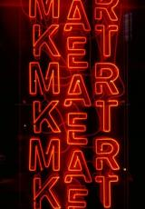 The word 'Market' written in red against black background