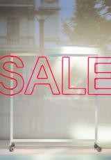 Sale written on a glass panel