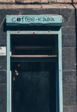 A coffee place entrance door