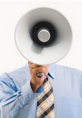 man holding a loudspeaker in front of his head